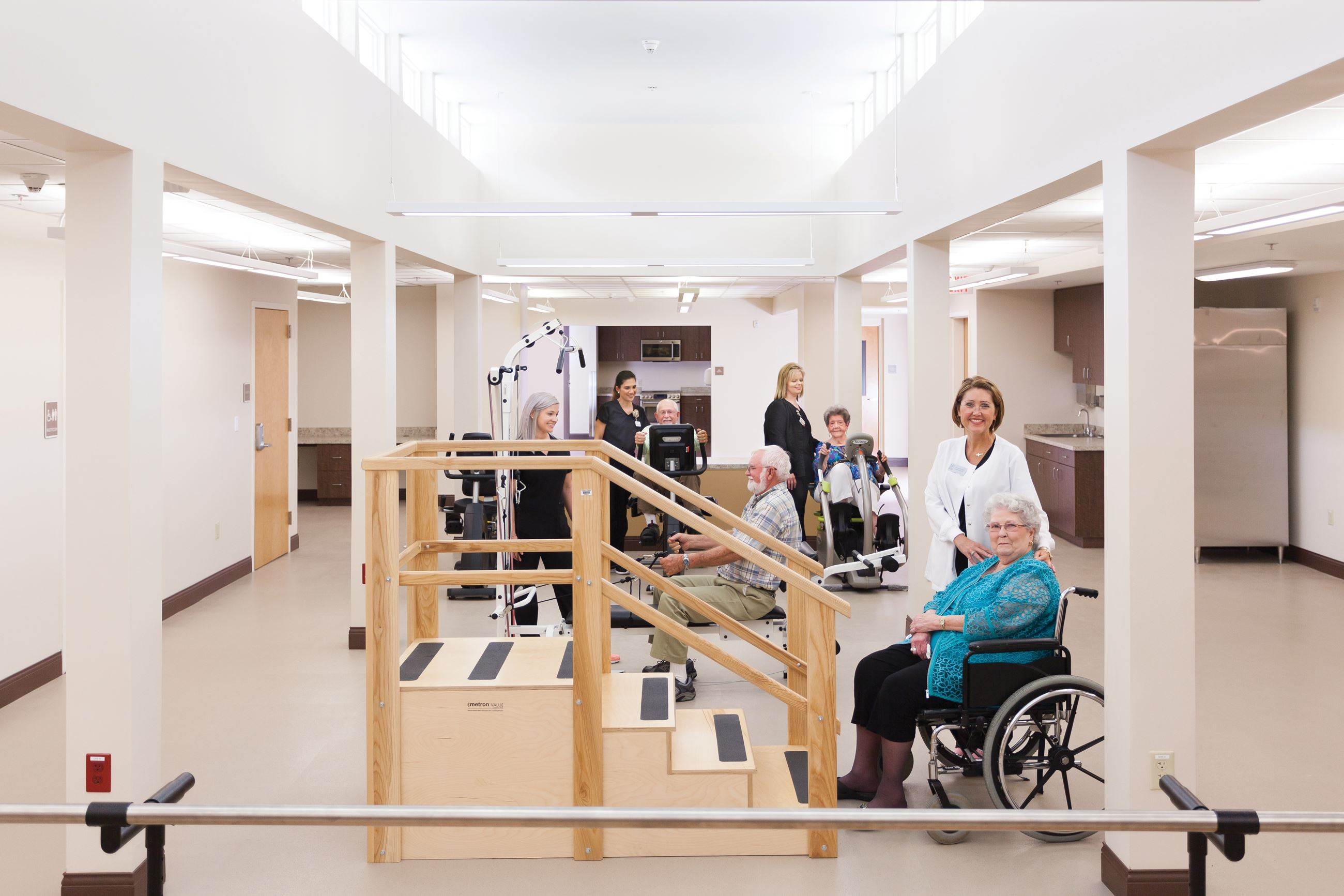 MHRC Therapy Gym with staff and residents