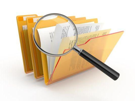image of file folders and magnifying glass